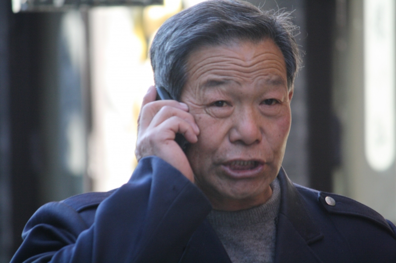 Chinese Man on Cell Phone